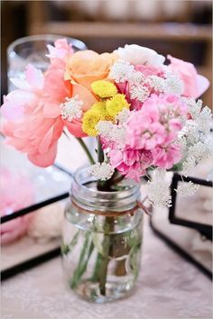 boho pastel flowers mason jar wedding centerpiece /  http://www.deerpearlflowers.com/cheap-mason-jar-wedding-ideas/2/