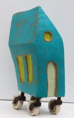 Rob Matthews and Leslie Guinan: OUTTA HERE. concrete, encaustic, antique porcelain caster wheels