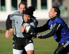Ma'a Nonu Photos Photos - Ma'a Nonu runs through the tackle of recalled All Black Luke McAlister in action during a New Zealand All Blacks training session at University Oval on June 8, 2009 in Dunedin, New Zealand.  (Photo by Ross Land/Getty Images) * Local Caption * Luke McAlister;Ma'a Nonu - All Blacks Training Session