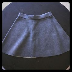 """Banana Republic Heather Gray Mini Skirt Size 6 Super cute Banana Republic heather gray mini skirt in a Size 6  Flattering A-line shape. So comfortable and versatile! Wear this skirt with anything! Brand new!Never worn! Hidden back zipper with hook & eye closure. Laying flat: Waist 15.5"""" Length 17"""". I consider reasonable offers! Banana Republic Skirts Mini"""