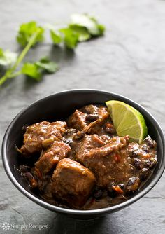 Hearty pork and black bean stew with pork shoulder, onions, red bell peppers, jalapeños, garlic, cornmeal, black beans, spices, molasses, and a splash of lime juice. Perfect for a cold day! ~ SimplyRecipes.com