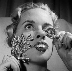 Salvador Dali jewelry... what girl doesn't want some of that?  Yeah, I'd like the dead droopy eye please.