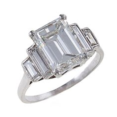 Fine Emerald-Cut Diamond Platinum Ring | From a unique collection of vintage engagement rings at http://www.1stdibs.com/jewelry/rings/engagement-rings/