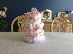 Me and my sister made a diaper cake. We used approximately 90 diapers. We did not use rubber bands we used yarn its better tightens up good. Also bought the supplies in Walmart. We did a great job.