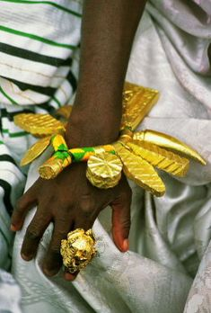 Africa | Close up of the gold jewellery worn by the Ashanti chiefs during the Durbar | © Bruno Zanzottera