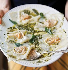 This autumnal dish of butternut squash ravioli with oregano-hazelnut pesto is easy to make using pre-made wonton wrappers.