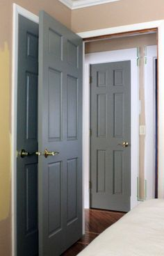 Canu0027t Wait for Paint | Our Humble Abode gray interior doors & Chic hallway features white walls fitted with gray paneled doors ...