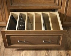 kitchen drawer storage. no more pulling all trays out to get the one you want.