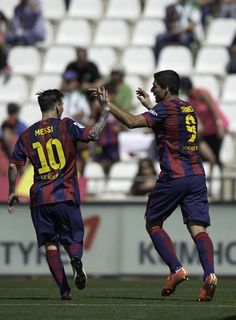 Luis Suarez (R) of FC Barcelona celebrates scoring their second goal with team-mate Lionel Messi (L) during the La Liga match between Cordoba CF and Barcelona FC at El Arcangel stadium on May 2, 2015 in Cordoba, Spain.