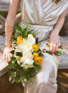 Bride in a Gold Dress with a Yellow Ranunculus Spring Bouquet | Floral Design by AMBER REVERIE | See More: http://blog.amberreverie.com/2015/03/intimate-brooklyn-ny-wedding.html
