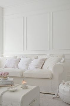 Look closely.....there's nothing hugely expensive in this all-white room. The key to its success is consistency.