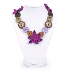Unique necklace made of hand-crocheted flowers and wooden buttons by widows in India.