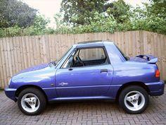 Suzuki X90 4WD... my first car/truck... except mine was black with pink n purple detailing!