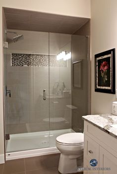 Small bathroom with walk in shower. Glass doors, fibreglass base, mosaic tile ni… Small bathroom with walk in shower. Glass doors, fibreglass base, mosaic tile niche and large porcelain wall … Bathroom Renos, Master Bathroom, Budget Bathroom, Basement Bathroom Ideas, Navy Bathroom, Loft Bathroom, Bathroom Laundry, Master Baths, Basement Kitchen