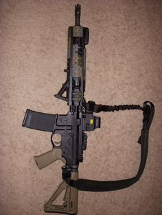 """My pirate gun!!  I call it """"Anne's Revenge""""   (AR-15 w/ mid-length gas system and holographic site)    Amazing!!"""