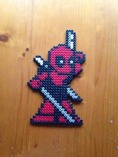Deadpool Pixel Perler Bead Sprite Fridge Magnet by PixelatedPleasantry Pixel Beads, Fuse Beads, Pearler Beads, Melty Bead Patterns, Perler Patterns, Beading Patterns, Cute Crafts, Bead Crafts, Arts And Crafts