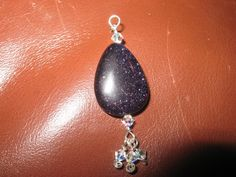 """""""Looking to the Stars"""" pendant in blue goldstone, sterling silver, and swarovski crystal."""