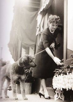 Jacqueline Bouvier Kennedy Onassis with her Poodle friend in France also was a 1st Lady