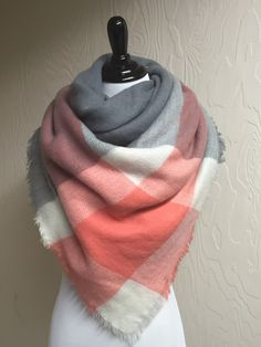 Beautiful acrylic over-sized blanket scarf in a peach and gray striped color-block pattern with fringe ends. This sweet scarf will keep you styled and cozy warm!