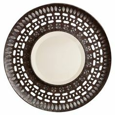 """Distressed metal wall mirror with openwork frame.  Product: Wall mirrorConstruction Material: Metal and mirrored glassColor: BrownDimensions: 23.75"""" Diameter"""