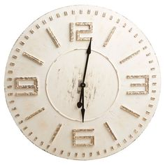 Brimming with rustic appeal, this wood wall clock showcases a weathered paint finish for a touch of pastoral warmth. Product: Wall clockConstruction Mater...
