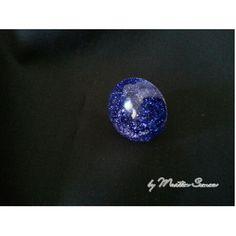 Dark blue glitter gloss vision ring.  Price € 13,00