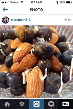 Extreme close-up of my morning snack. Almonds and blueberries, with a dash of cinnamon and sprinkle of unsweetened coconut. Crunchy, sweet, filling, and packed with nutrients! #eatclean #cleaneats #snack | peak313.com , facebook.com/peak313, IG: clarepeak313