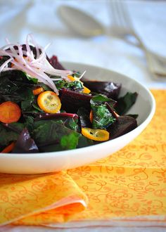 """Roasted Beet, Kumquat and Wilted Beet Greens Salad with Garlic-Honey Vinaigrette. Lots of """"good for you"""" going on here."""