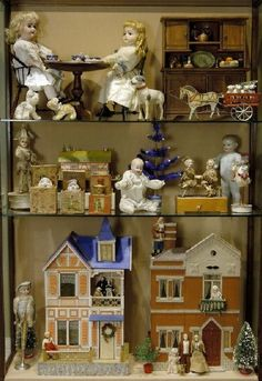 Cabinet full of miniature toys  http://www.hometraditions.com/taft_museum_of_art_christmas_2005_s/1953.htm