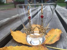 Ea-61 Star earrings with tiny red glass set stones, dangle earrings, vintage filigree brass star charms, choose findings, Christmas, Advent. by Tinord on Etsy