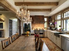 Stove/oven, white washed cabinets with mix matched hardware, chandelier, exposed brick, table and on and on and on.
