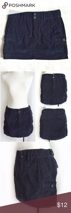 "Old Navy Dark Blue Cord Cargo Mini Cute, casual multi-seasonal mini skirt. Pair it with your favorite tights and a slouchy sweater. Super soft, fine-wale corduroy in navy blue. Slant hip pockets, two back flap pockets and two side cargo pockets. 100% cotton. Size 4. Waist: 15"".  Length: 14"". EUC. Thanks for looking! Old Navy Skirts Mini"