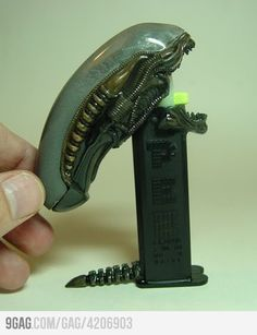 "Alien Pez Dispenser by Peter ""Rat D"" Davidson    http://www.toycutter.com/2010/08/alien-pez-dispenser.html?m=1"