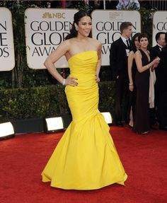 Paula Patton paired her bold dress with simple diamond earrings and a bracelet.