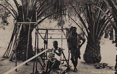 Africa | Weaver at work.  Gold Coast, Ghana. || Vintage photographic print postcard.