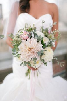 Pale pinks, whites, and succulents made for a pretty bouquet - come see all this bride's style