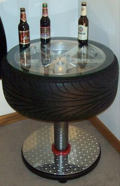 Car parts as everyday household items *For the Man Cave - a cool tire table. Tire Table, Tire Chairs, Tire Craft, Car Furniture, Automotive Furniture, Automotive Decor, Furniture Ideas, Man Cave Furniture, Automotive Upholstery