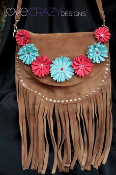 Fringe suede purse with handmade leather flowers.