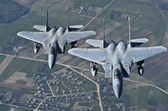 Maj. Barak Amundson and 1st Lt. Matthew Scott, 493rd Expeditionary Fighter Squadron pilots, fly over Lithuania in F-15 Eagles during a training mission with the Lithuanian air force April 23, 2014. The 48th Air Expeditionary Group has been conducting the Baltic Air Policing mission here since January and will be handing over the mission to the Polish air force at the beginning of May. (U.S. Air Force photo by Airman 1st Class Dana J. Butler/Released)