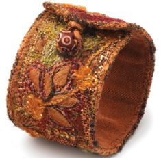 cuffkennedyNL  I think this would be fun to make!  Don't know how to do embroidery stiches with my machine but could do thread painting or decorative stitches or even hand stiches.  Oh the possibilities!