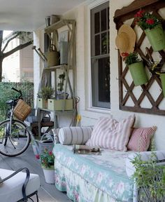 I love this lattice board.  I would mount it over the large screen area that faces the carport & use it like they have to store & display my gardening items.