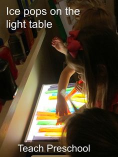Ice Pops make beautiful colored bars for patterning on the light table.  The colors are brighter and more translucent when the Ice Pops are unfrozen.