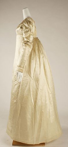 1823 Wedding dress back in the 1970's I used to say this style was the perfect wedding dress. if the bride found herself pregnant she could simply turn it around and head down the aisle.