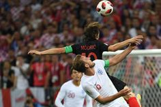Croatia's midfielder Luka Modric vies for the header with England's forward Harry Kane during the Russia 2018 World Cup semifinal football match...