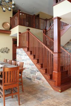 Stair Systems | craftsman style staircase; dark stain with light colored stone accents | Bayer Built Woodworks