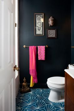 Wild card pairing: brights. A flash of hot pink, neon yellow or vibrant turquoise is daring — and exciting! Brights work best with black or charcoal; adding these bold hues to a room painted another dark color (like navy or forest green) is riskier. Test out a fun color pairing with a low-cost addition like hand towels or a cluster of bright vases.