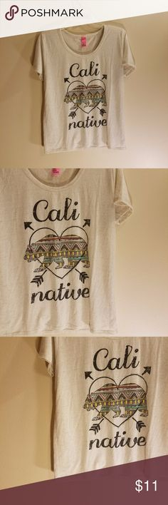 Just Ginger Cali Native graphic tee Just Ginger Cali Native graphic tee In good condition. No rips or stains. Barely worn. 85% cotton.  15% linen.  EVERYTHING MUST GO!🌻check out my closet! HUNDREDS or available items in a VARIETY of sizes 🌻 add to BUNDLE to receive a private discount 🌻 BUNDLE to save on shipping! 🌻 Just GInger Tops Tees - Short Sleeve