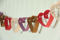 Homemade Valentine Craft Activities | homemade valentine swag. construction paper and yarn. Cute and looks easy enough!