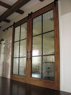 track doors - breakfast room/kitchen? Love the waterfall glass Love the handles…