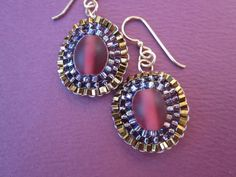 red Czech glass with purple and bronze seed bead by Adesso Jewelry (Etsy)